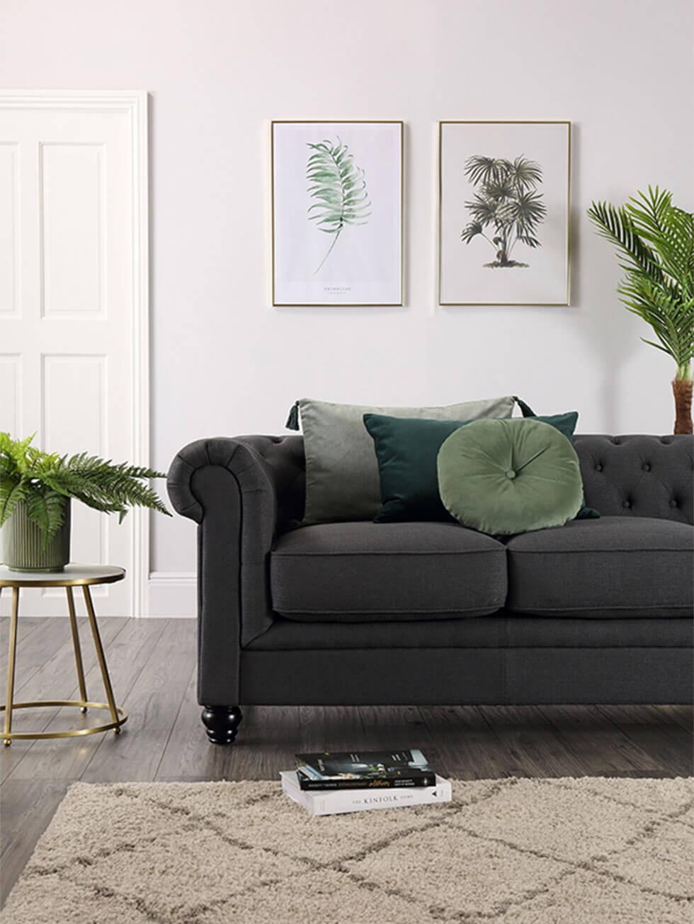 dark grey fabric sofa in a modern living room with plants