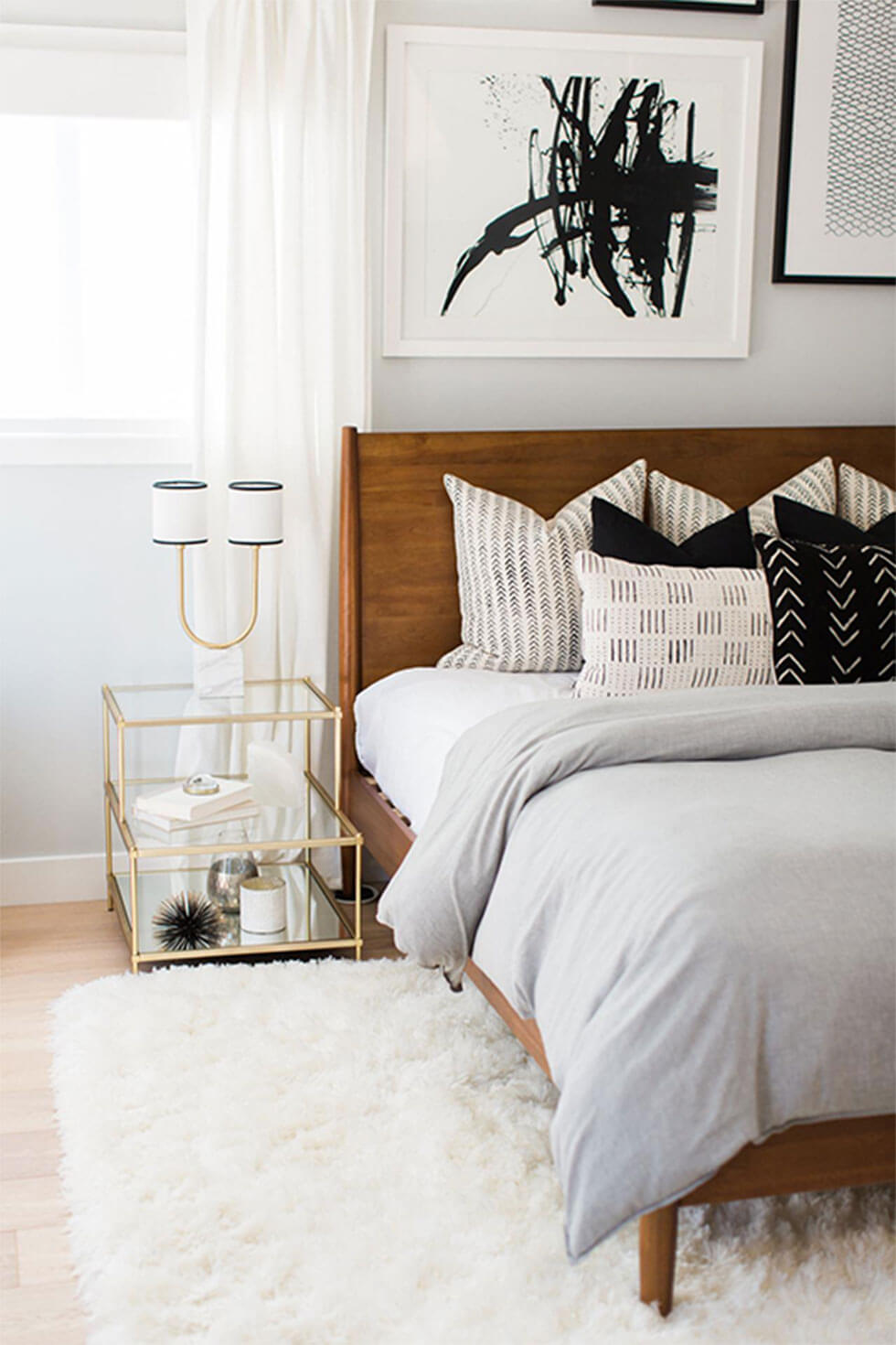 Wooden bed with many pillows for an extravagant feel