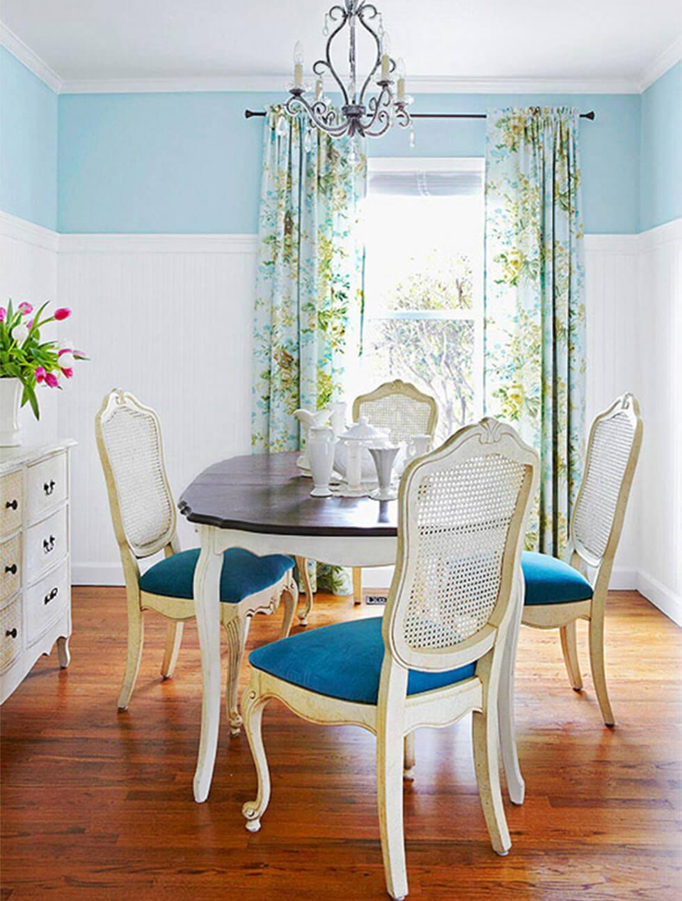 Two tone small dining room with white and blue walls, a classic dining set