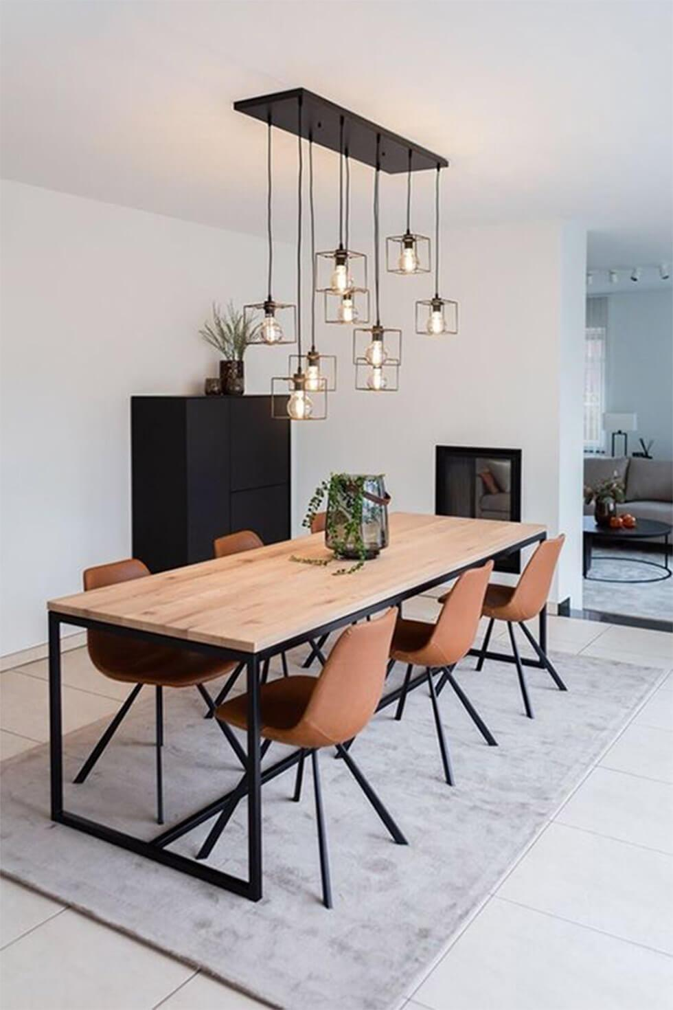 an industrial dining room with a wood and metal dining set