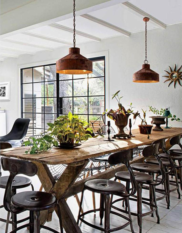 an industrial dining room with pendant lighting