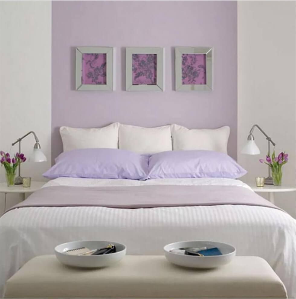 Bedroom with lavender purple feature wall and classic white bed