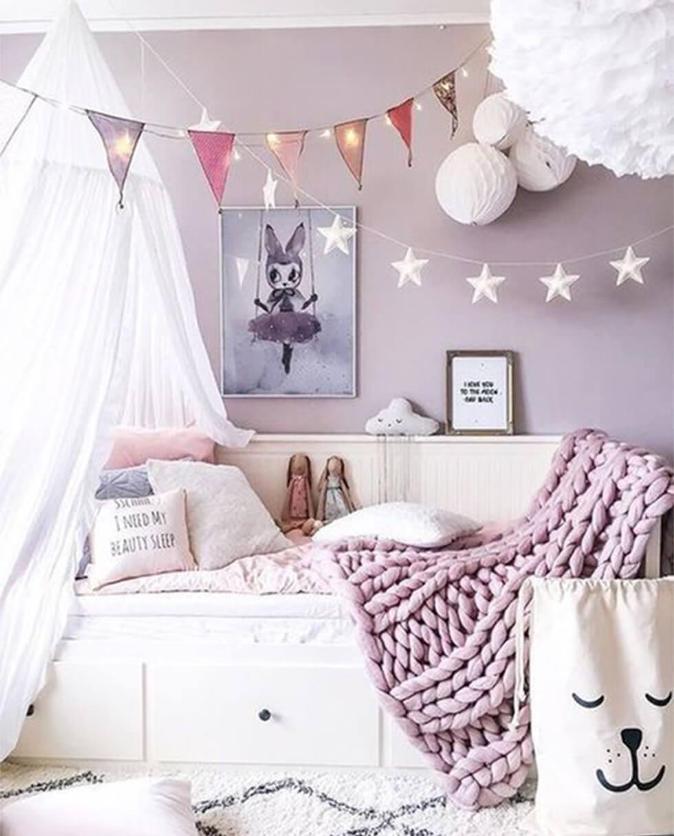 Lilac children's bedroom with canopy tent and soft toys
