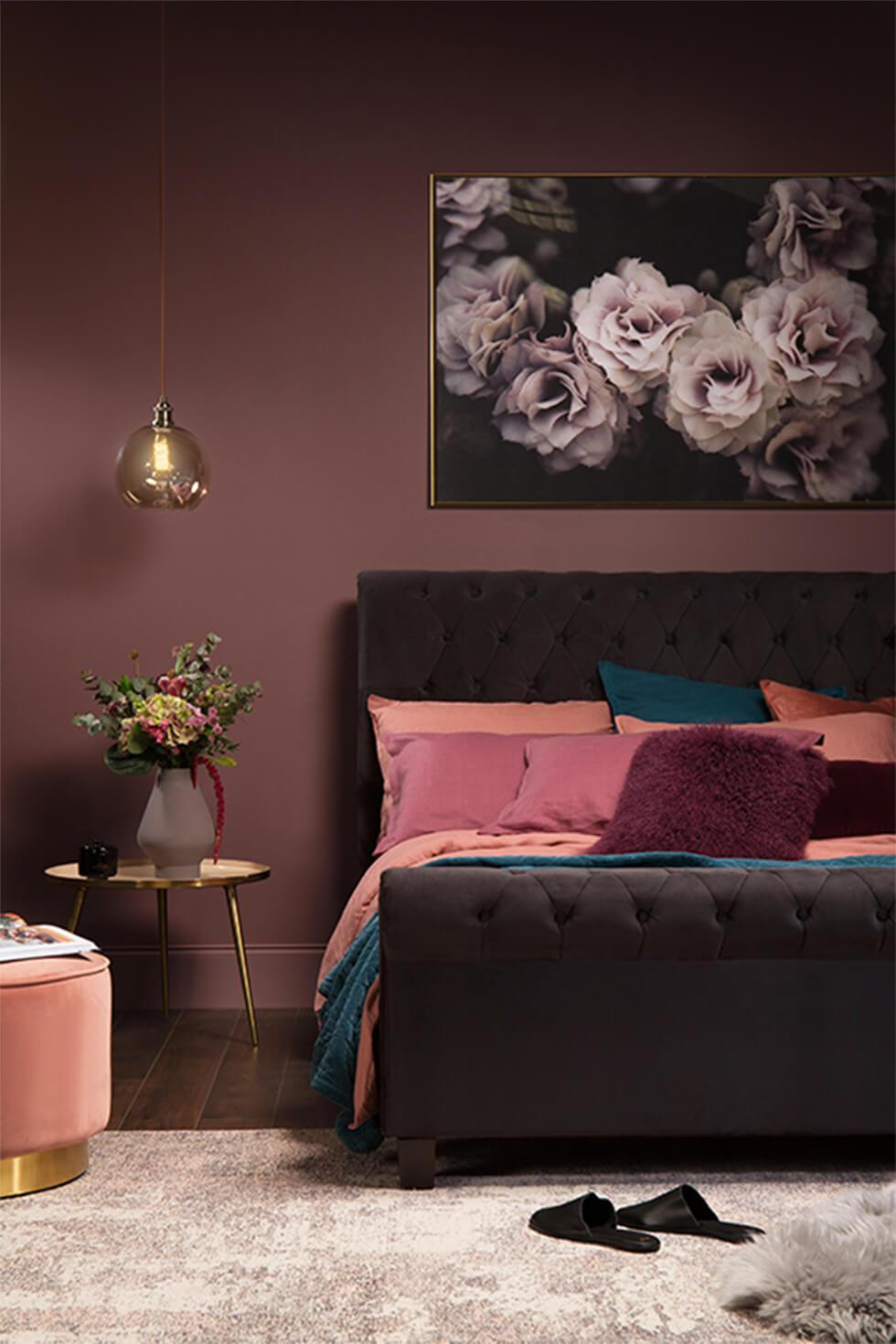 Jewel tone bedroom with black velvet bed