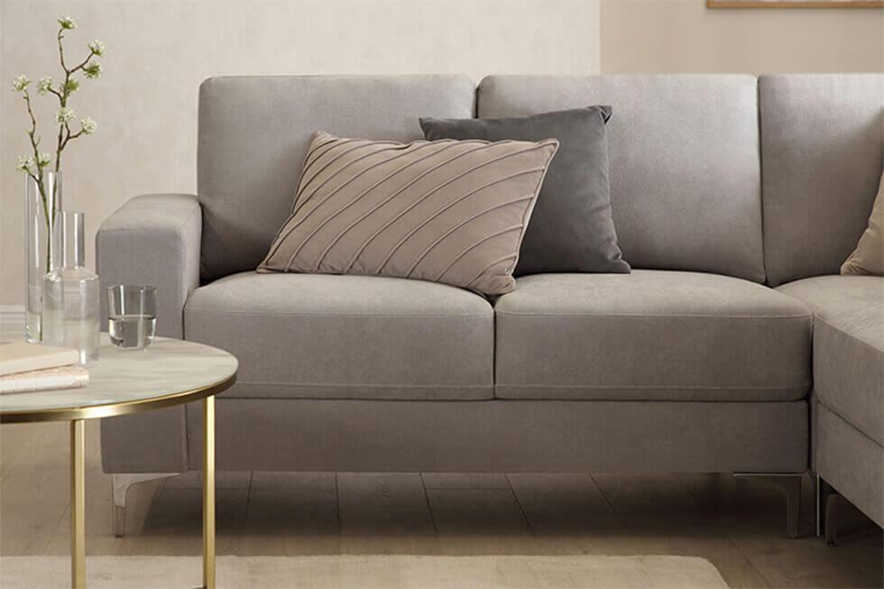 Sophisticated tonal grey room with grey fabric sofa and cushions