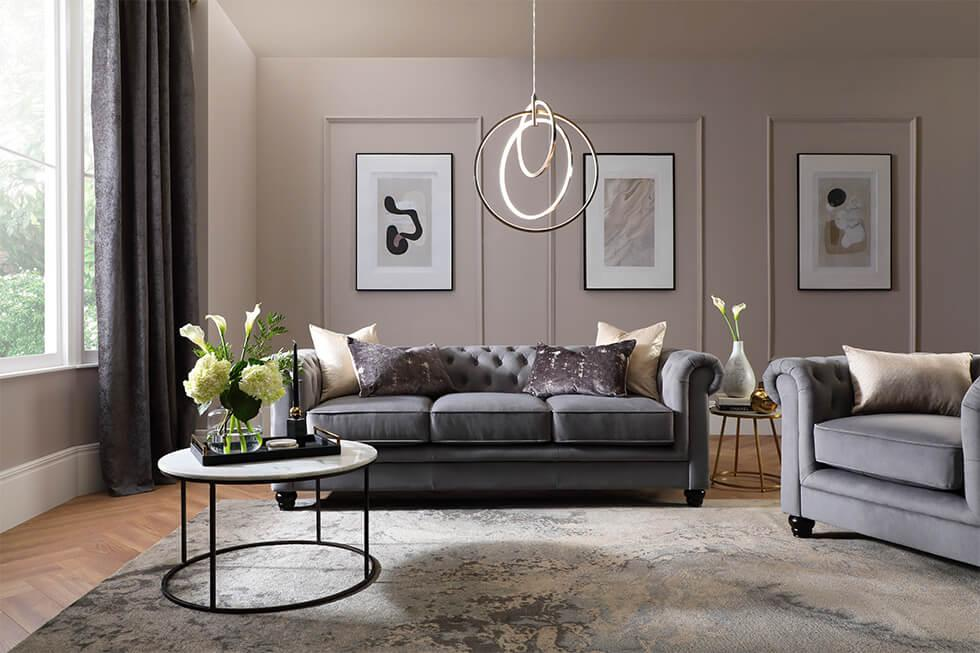 Grey chesterfield sofa in a luxurious living room