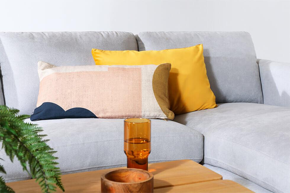 Colourful patterned cushions against a light grey sofa