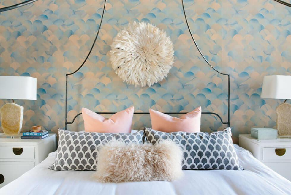 A bedroom feature wall in a pastel watercolour look.