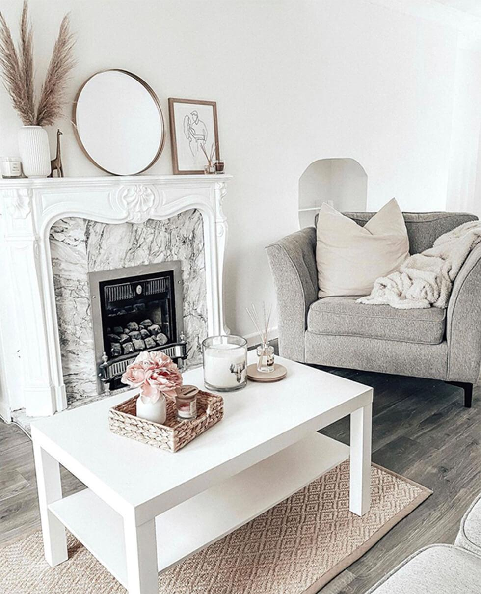Stylish neutral living rooms with framed pictures on mantelpiece