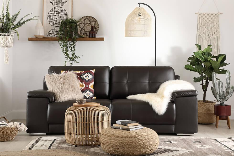 Modern bohemian living room with a statement rattan standing lamp
