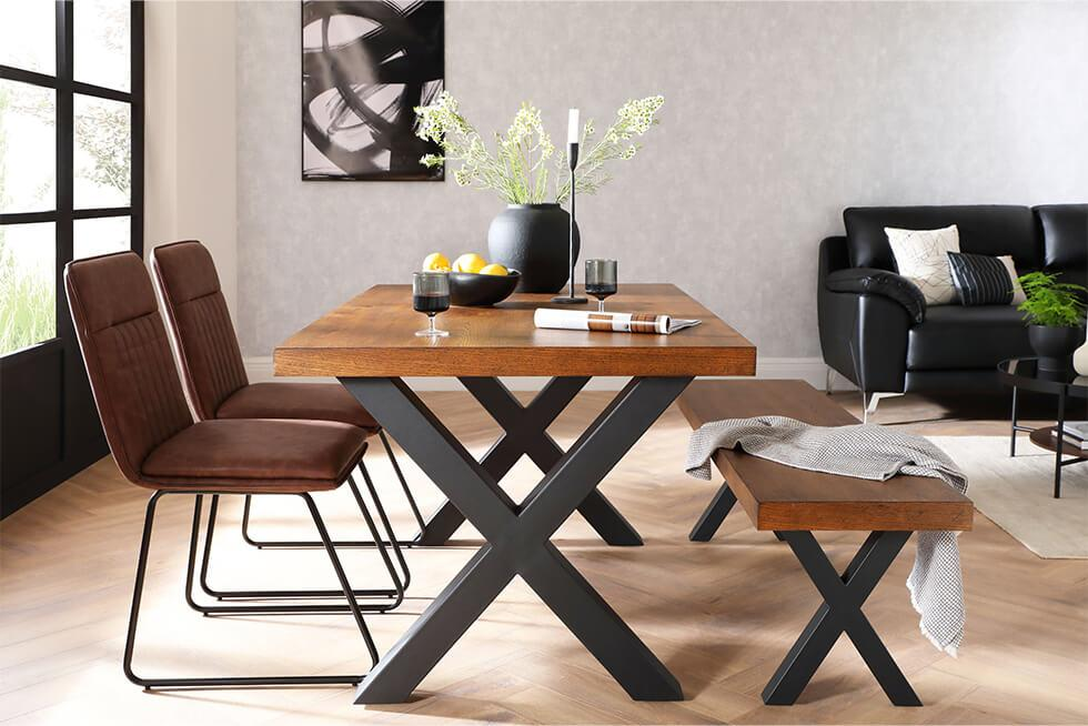 Industrial dining set in an open plan space with a concrete effect wallpaper
