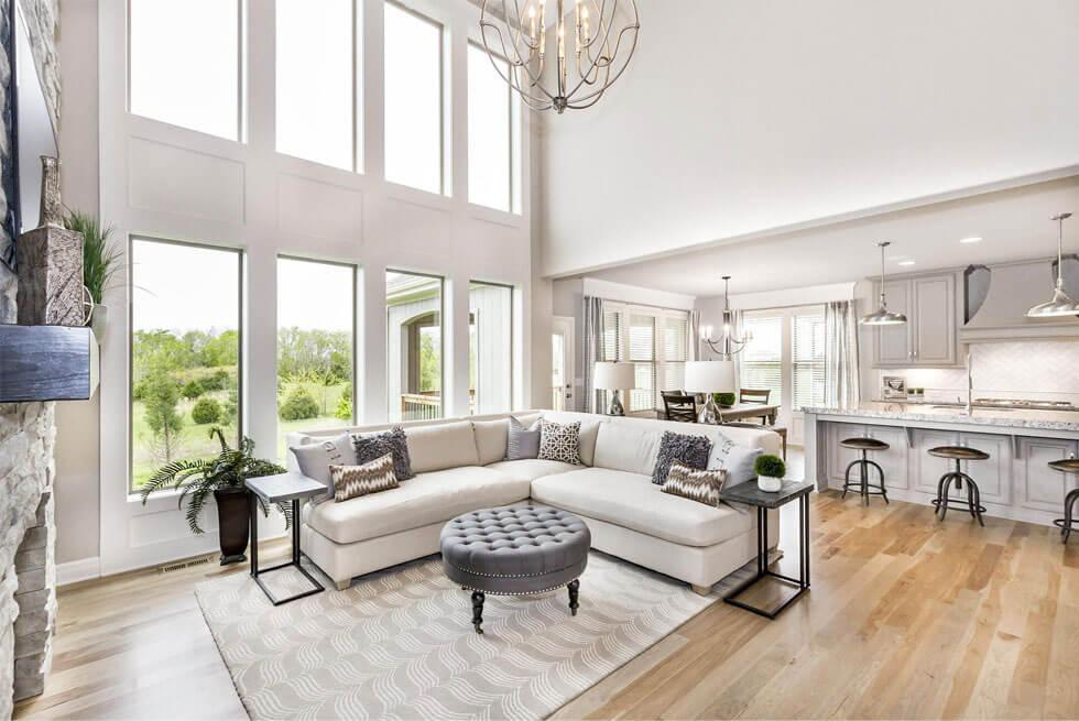 An open space living room layout design that has the same style elements as the kitchen.