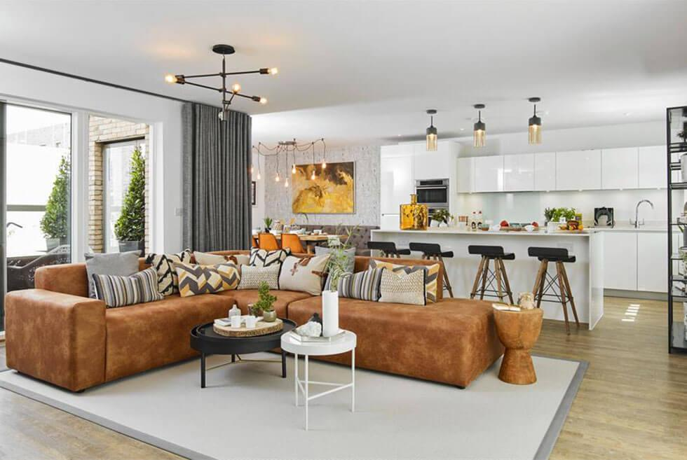 A leather sectional sofa in an open space living room layout.
