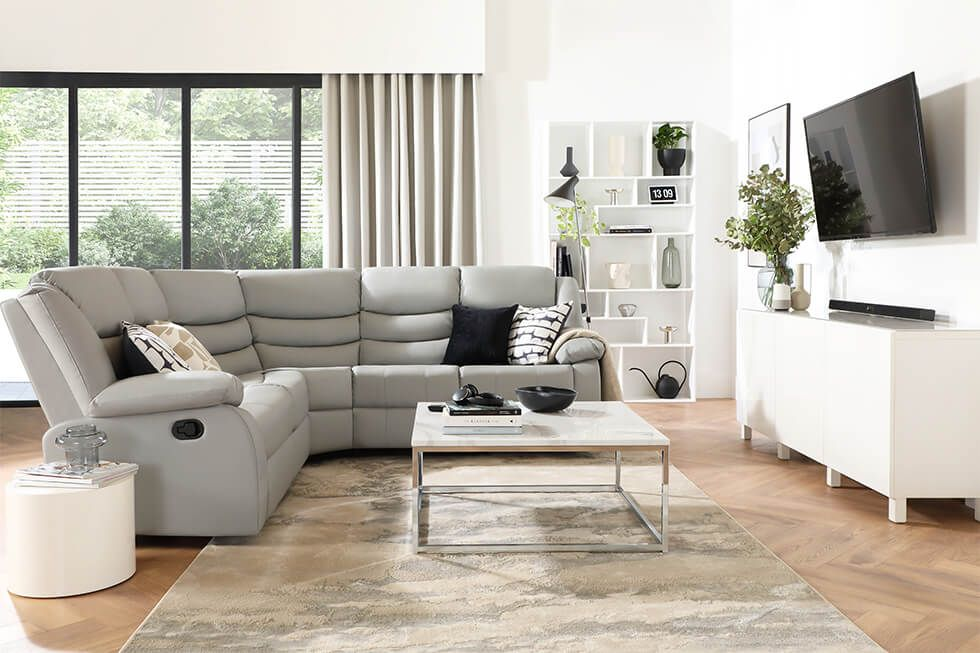 Large corner sofa with a living room layout with high ceilings.