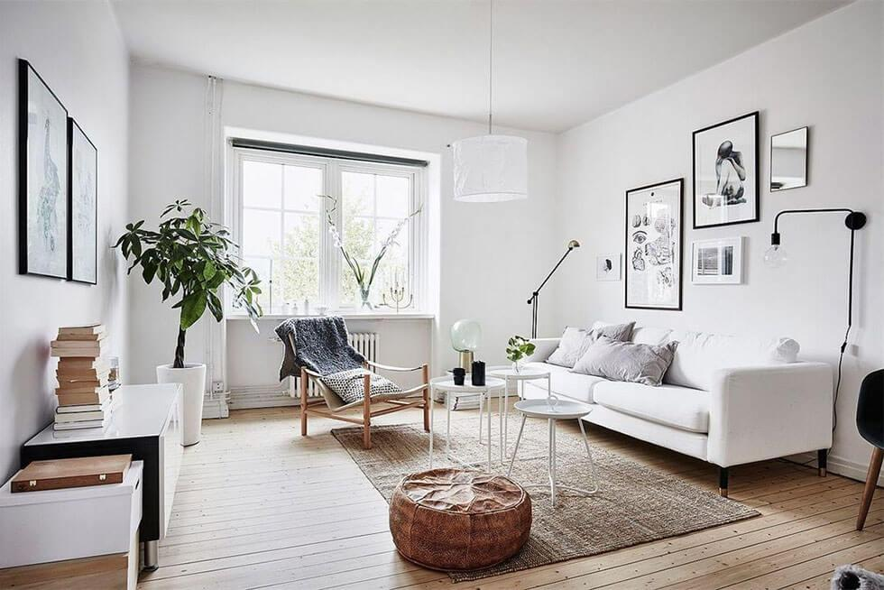 Neutral Scandinavian style living room with a white sofa and natural accessories