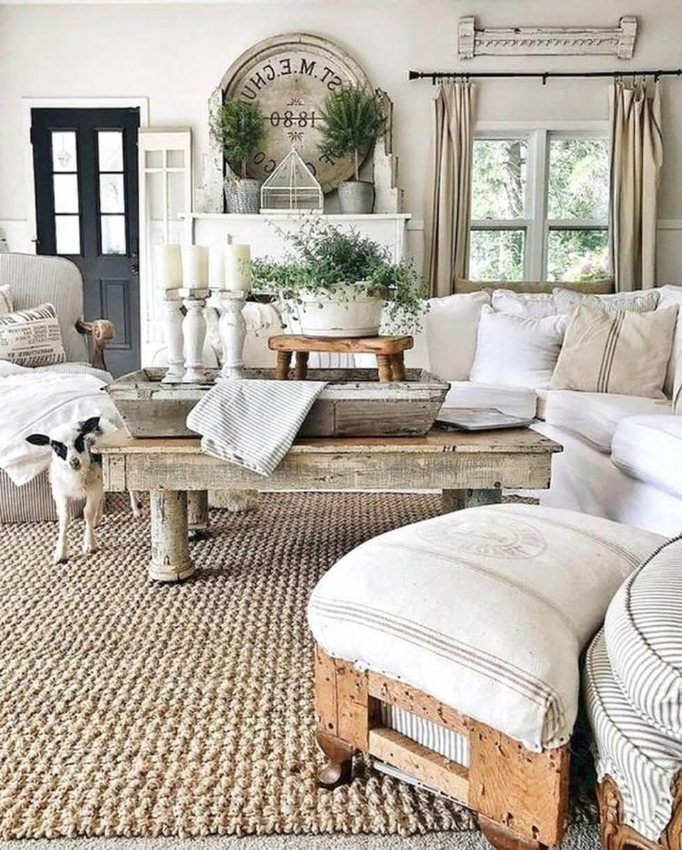 Neutral living room in a classic farmhouse style with taupe sofas