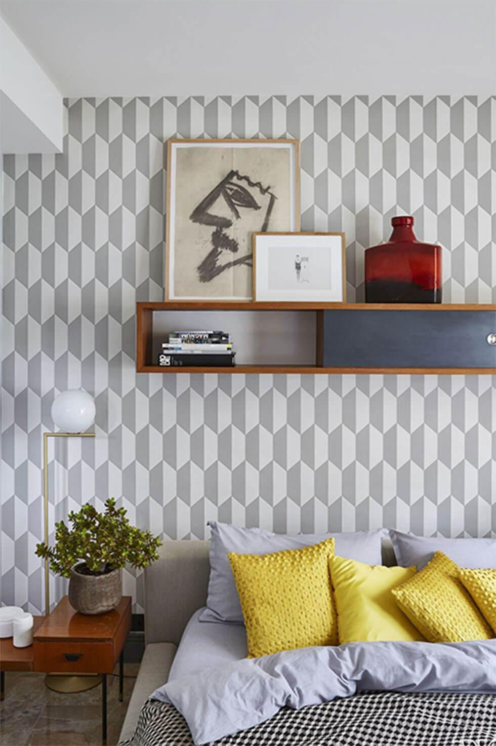 Bedroom with a grey patterned wall.