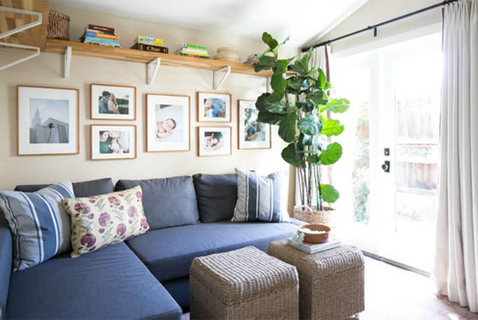 Country living room with large blue corner sofa