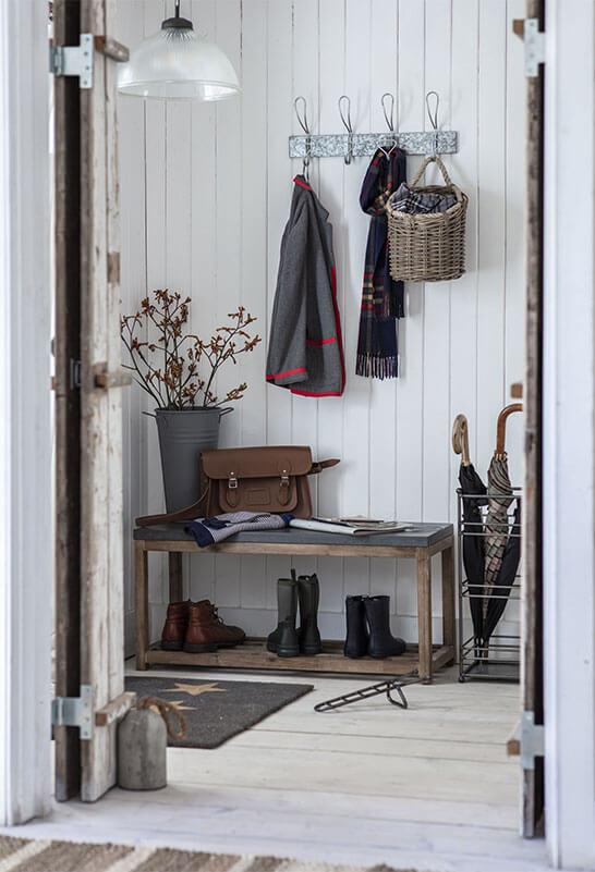 hallway closet with a coat, scarf, umbrellas and boots.