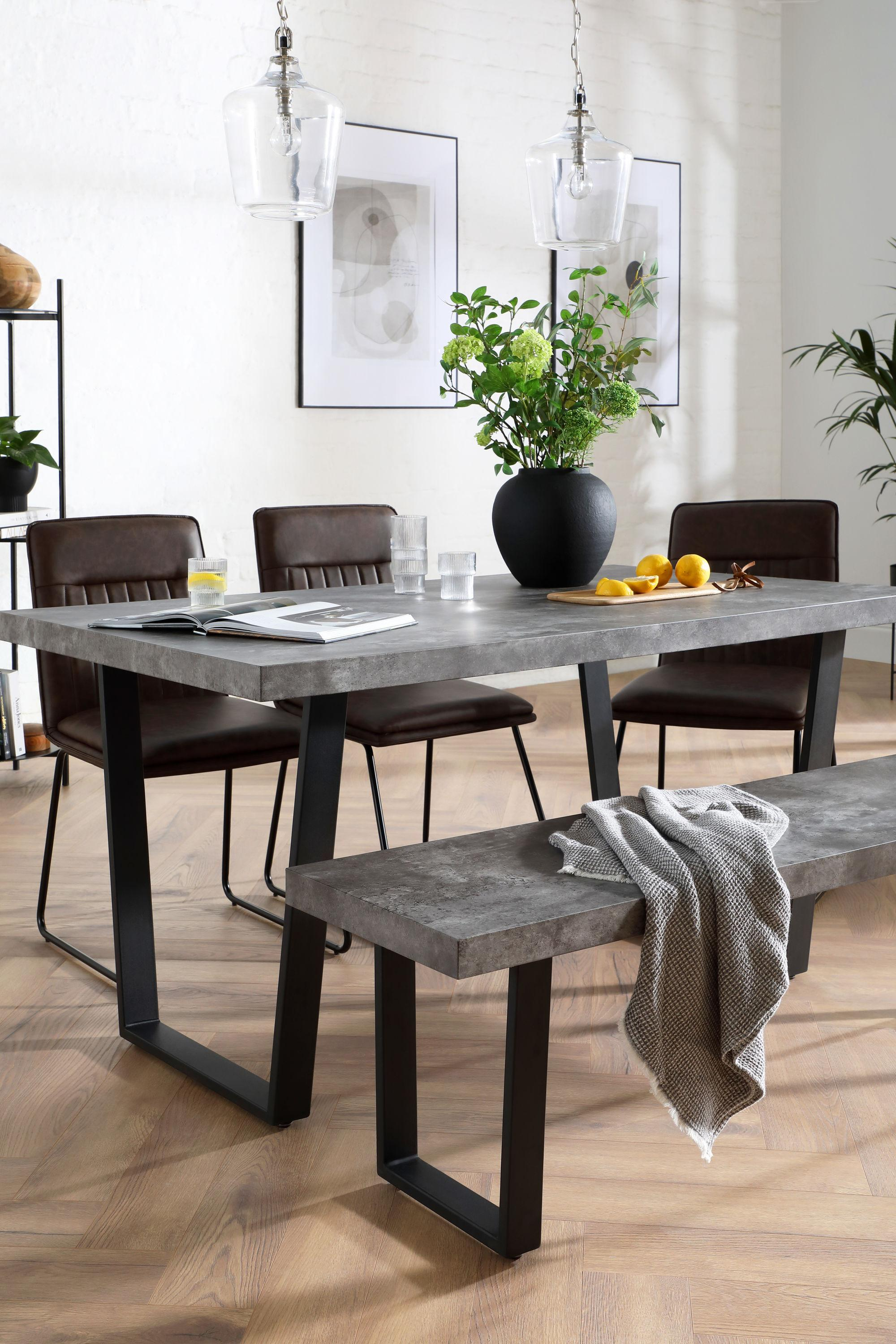 Industrial dining set with concrete table and leather chairs