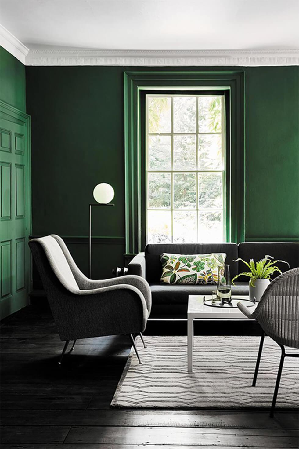 Dark green living room with grey sofas
