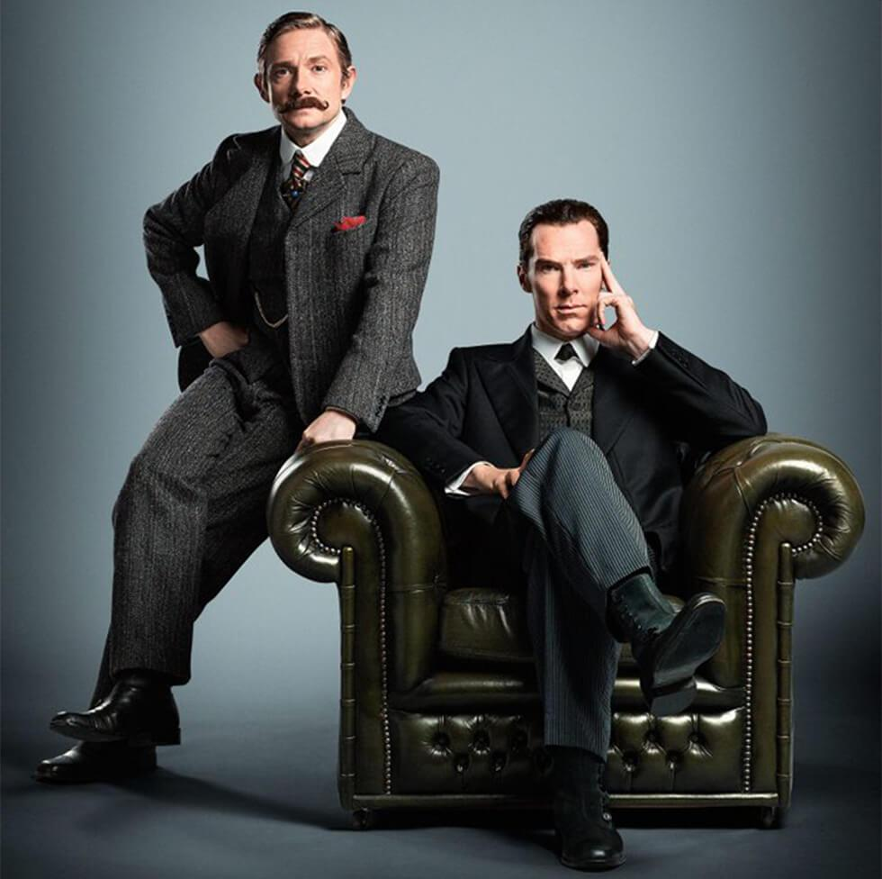 Sherlock Holmes and Dr Watson on a leather Chesterfield armchair