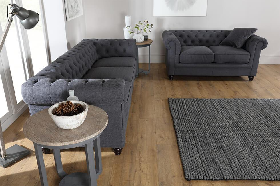 Furniture Choice grey fabric Chesterfield sofa set in a contemporary Scandinavian living room