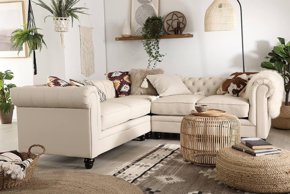 Furniture Choice oatmeal fabric Chesterfield corner sofa in a relaxed neutral bohemian living room