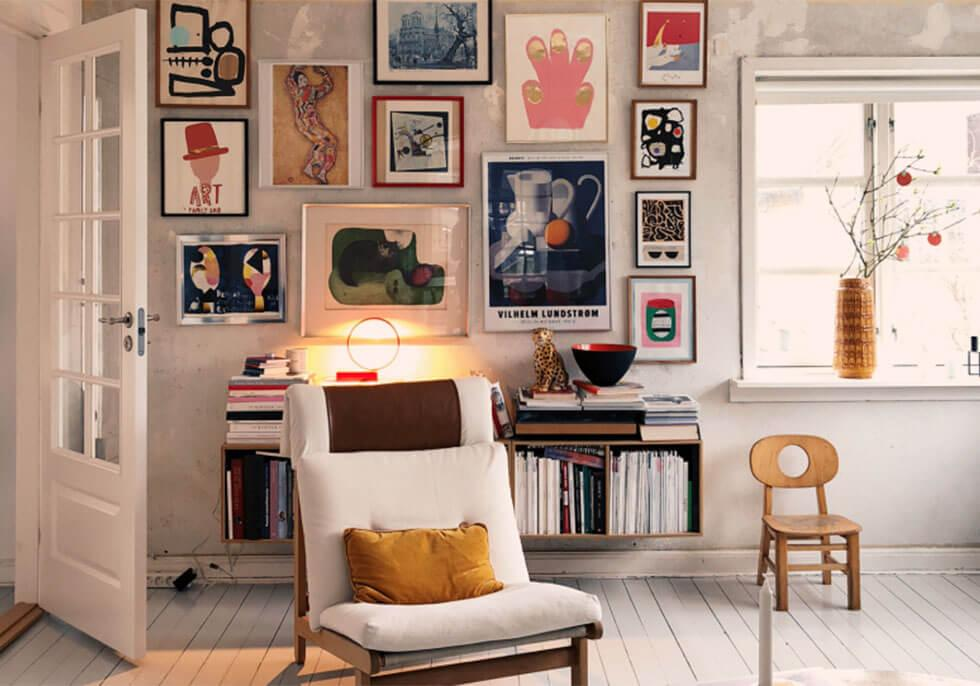 Colourful gallery wall with art and posters