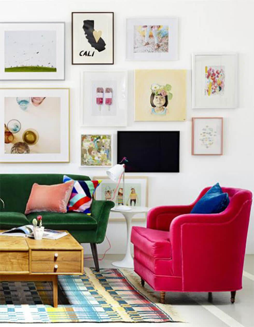 White living room with framed artwork and posters