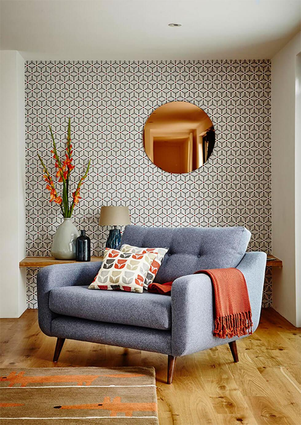 Cosy living room with geometric wallpaper feature wall