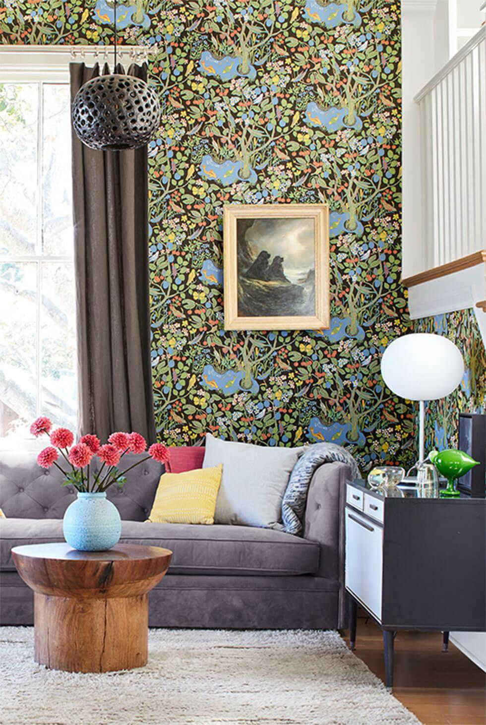 Living room with lush floral wallpaper