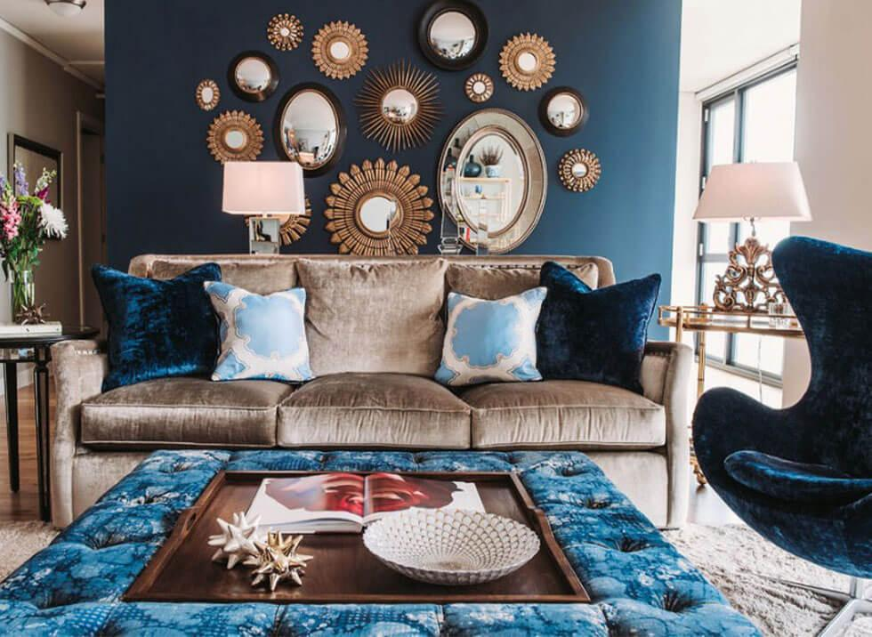 Living room with a feature wall displaying mirrors in different sizes and finishes