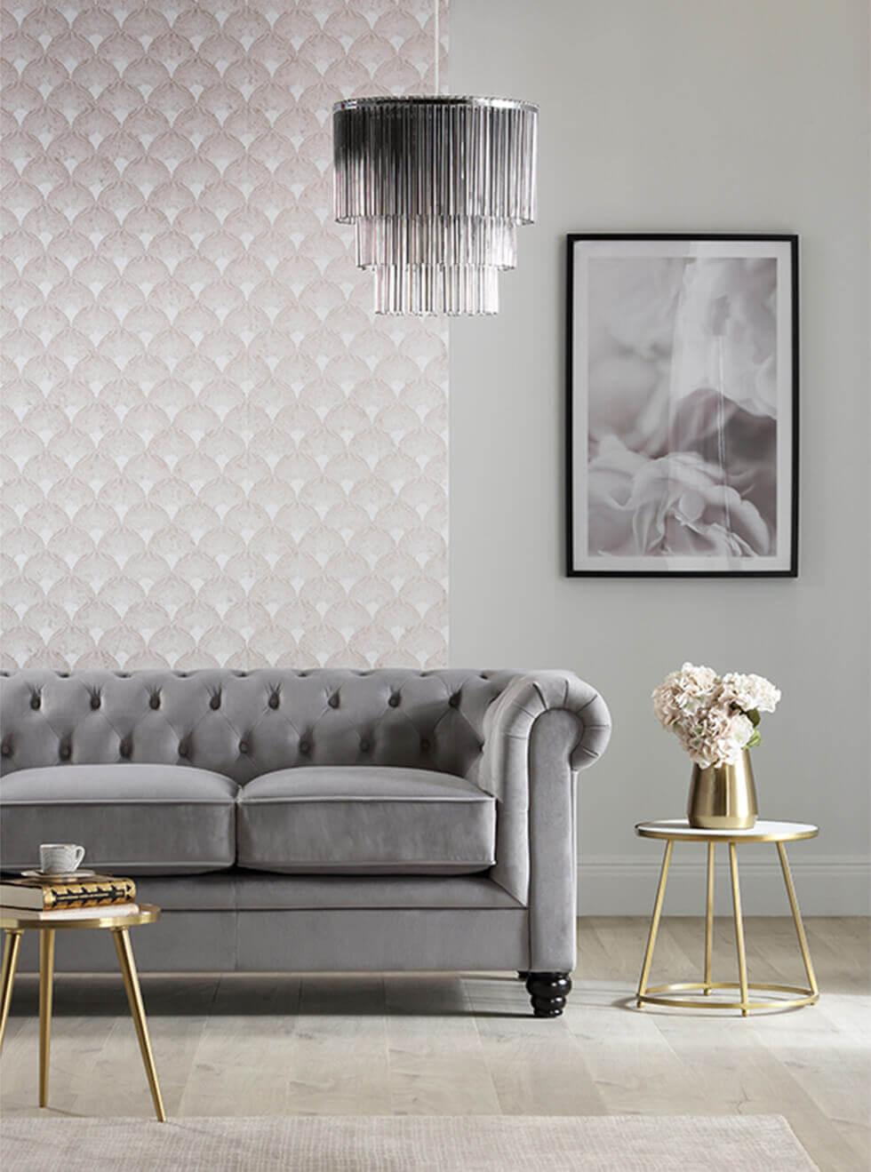 grey velvet chesterfield sofa in a modern luxe living room with a mid century inspired wallpaper