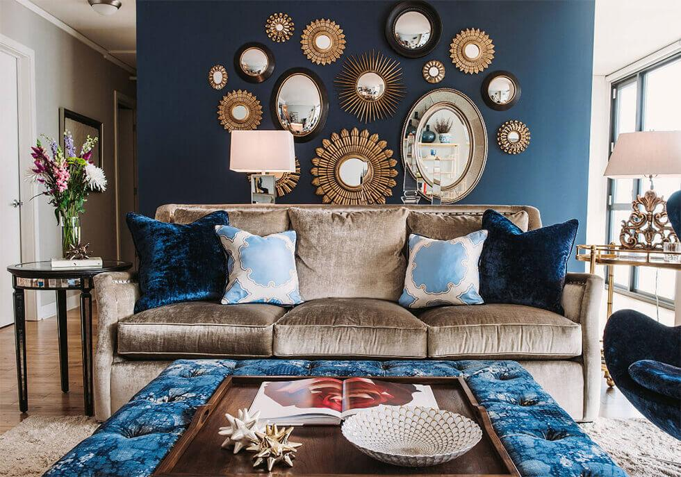 mirror gallery wall design in a blue living room
