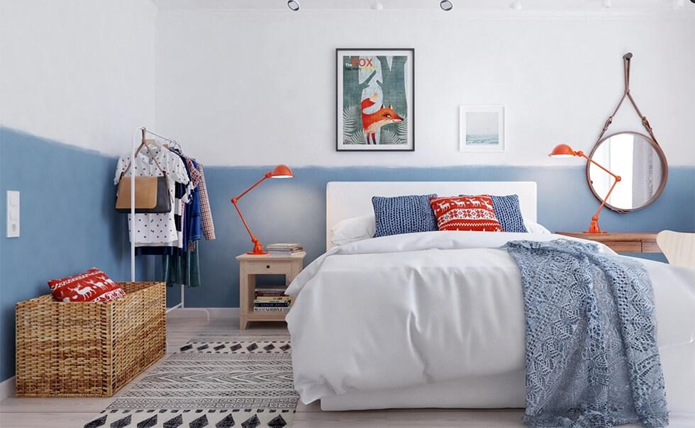 A modern and cosy bedroom with half-painted colour blocked walls in blue and white