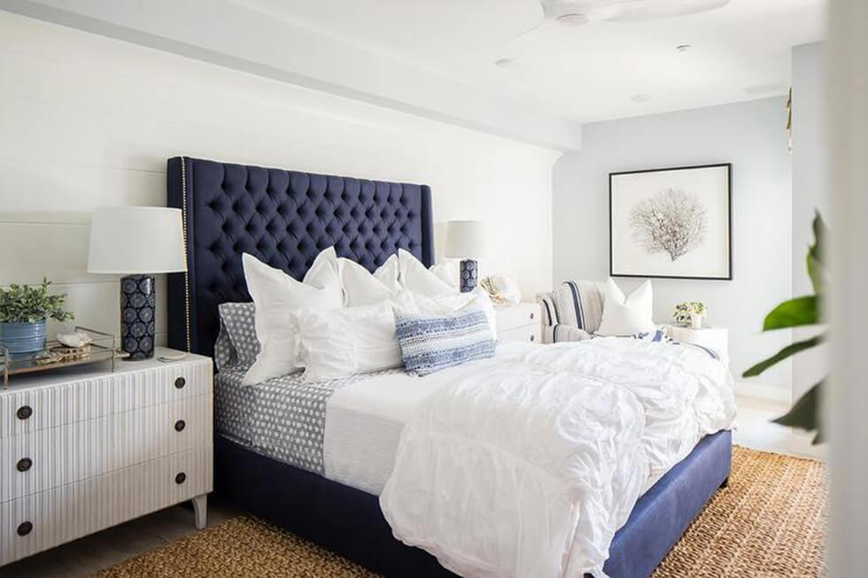 Neutral bedroom with a royal blue bed headboard