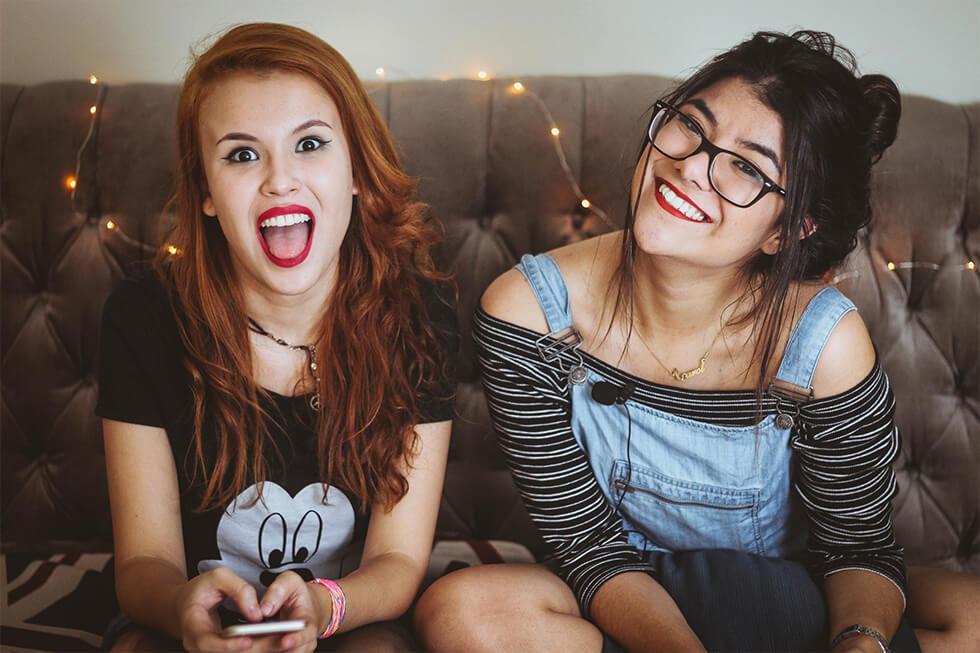two girls hanging out enjoying mindful living.