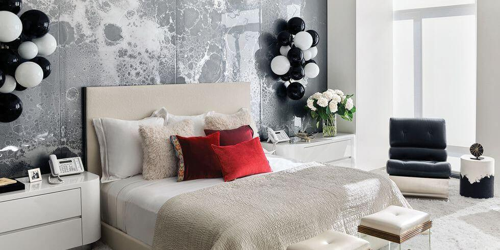 Modern bedroom with black and white balloon sconces and statement feature wall