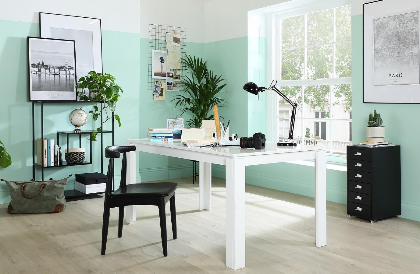Home office space with white desk and chair