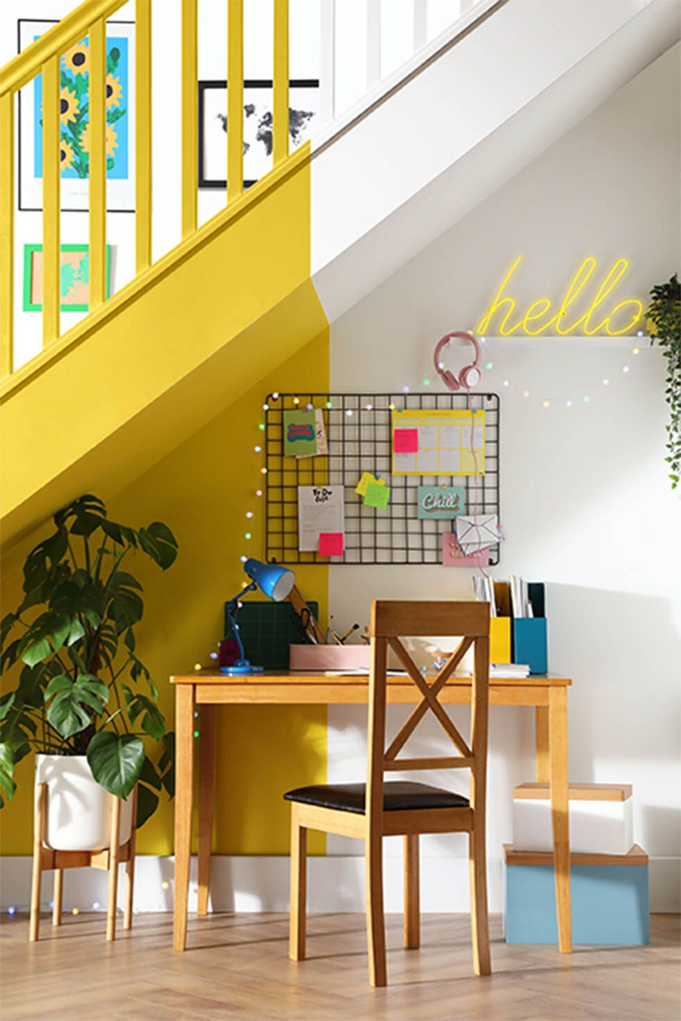 Bright yellow accents at an under stairs desk nook