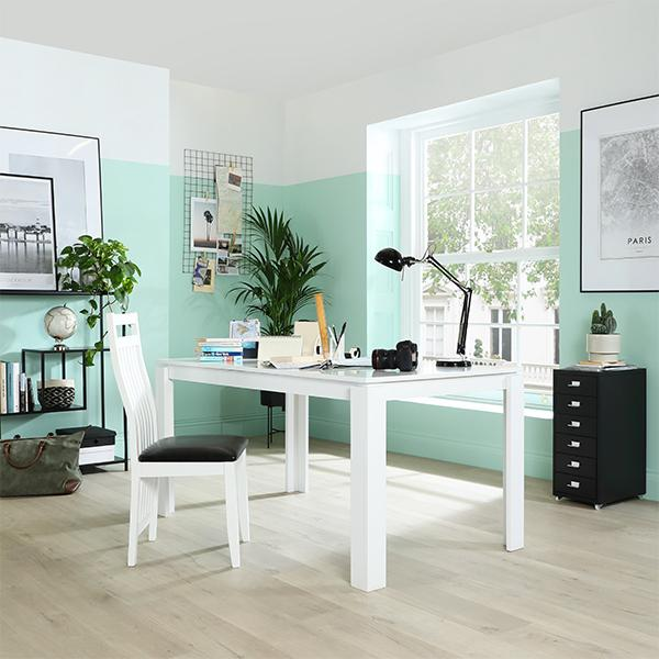 Colour blocked walls and white table and desk