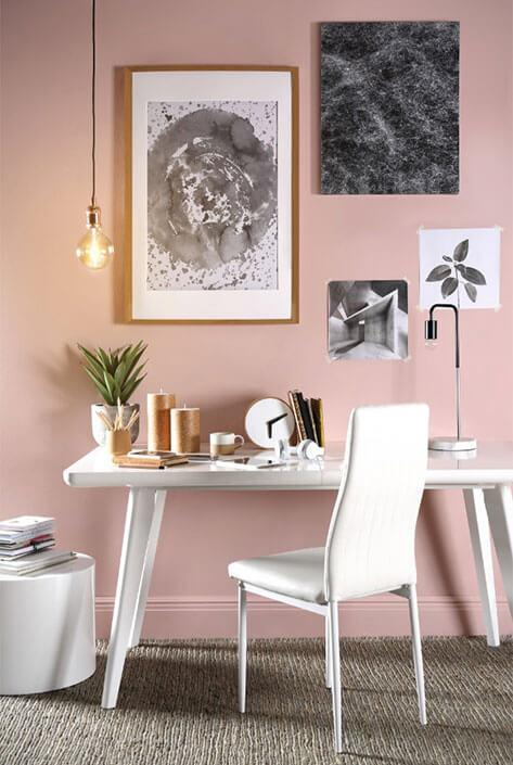 Home office with white desk and chair and light pink walls