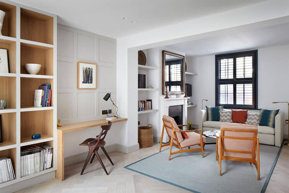 Living room with working desk wall panels