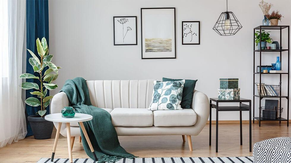 Green throw and pillows on a white sofa in the living room