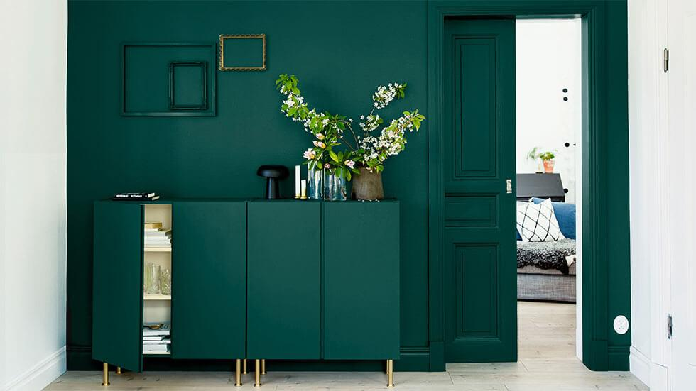 Emerald green console table and feature wall