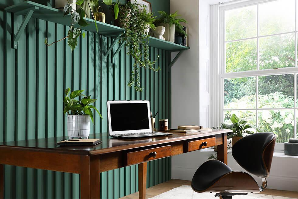 Hobby wood by earthborn green wall paint with a walnut dining table