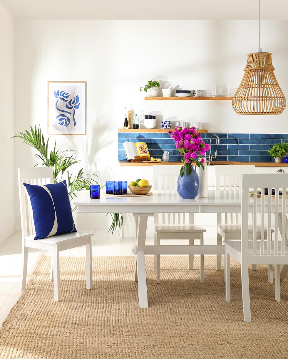 Greece-inspired dining room with a fresh white wooden dining set.