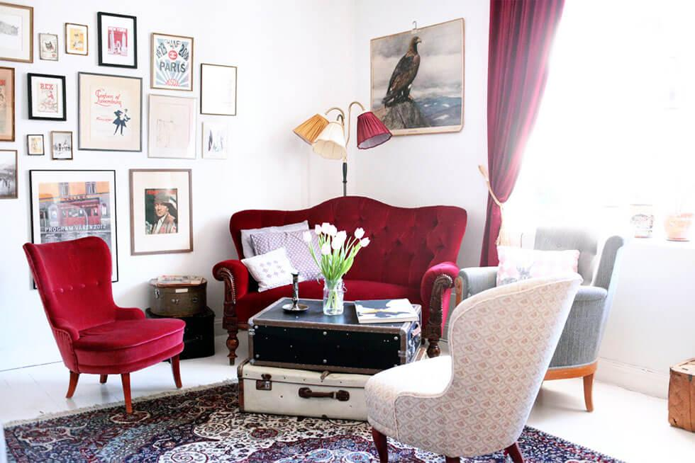 Statement red velvet sofa and armchair in a modern white living room