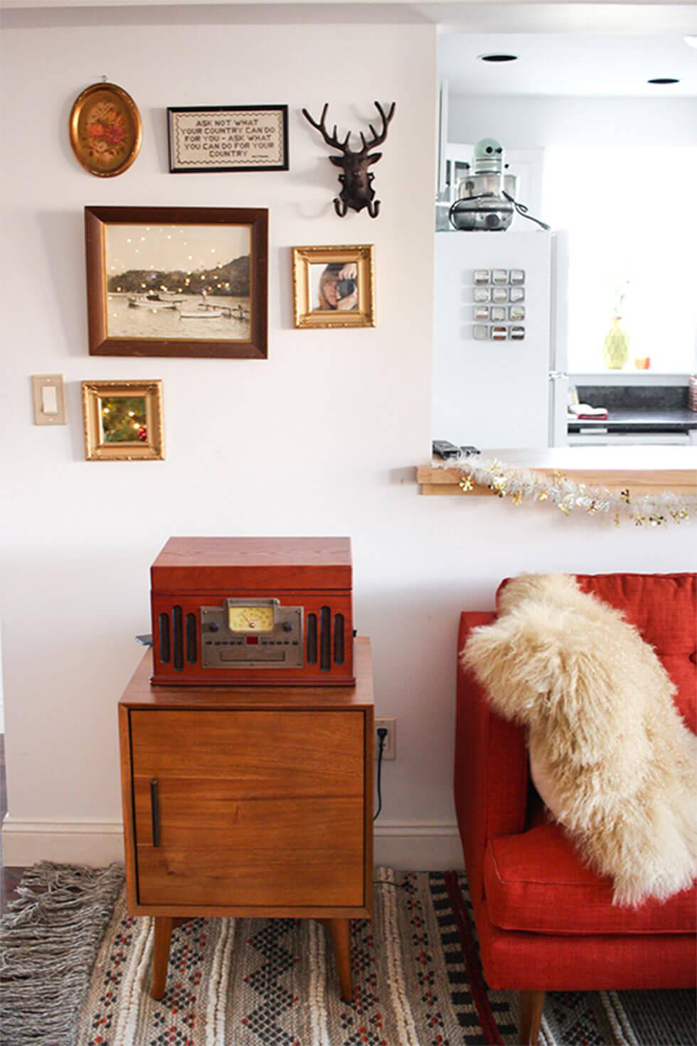 Vintage living room with a red sofa and a fur throw